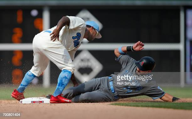 Second baseman Howie Kendrick of the Philadelphia Phillies tags out Rey Fuentes of the Arizona Diamondbacks attempting to steal during the eighth...