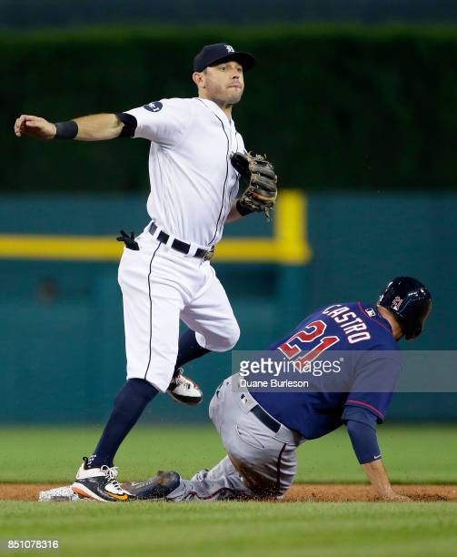 Second baseman Ian Kinsler of the Detroit Tigers avoids Jason Castro of the Minnesota Twins after turning the ball for a double play on Brian Dozier...