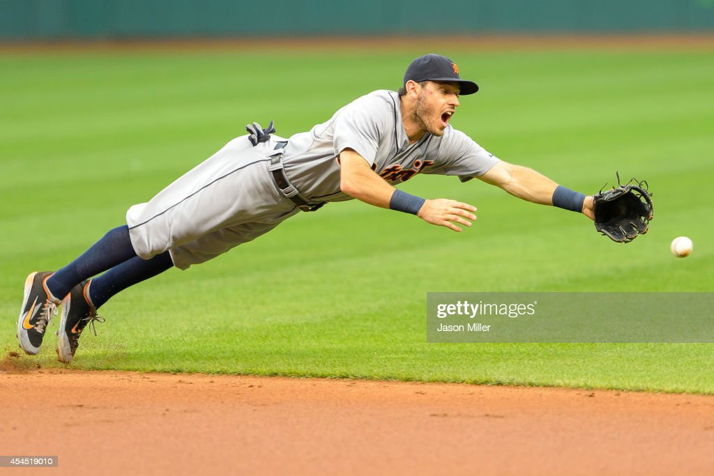 Second baseman <a gi-track='captionPersonalityLinkClicked' href=/galleries/search?phrase=Ian+Kinsler&family=editorial&specificpeople=538104 ng-click='$event.stopPropagation()'>Ian Kinsler</a> #3 of the Detroit Tigers dives for a ground ball off the bat of Michael Brantley of the Cleveland Indians during the first inning at Progressive Field on September 2, 2014 in Cleveland, Ohio.