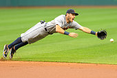 Second baseman Ian Kinsler of the Detroit Tigers dives for a ground ball off the bat of Michael Brantley of the Cleveland Indians during the first...