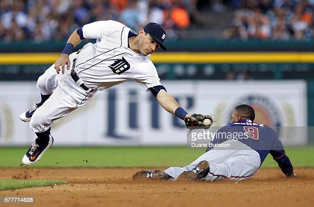 Second baseman Ian Kinsler of the Detroit Tigers makes a diving catch of a pickoff throw as Eduardo Nunez of the Minnesota Twins steals second base...