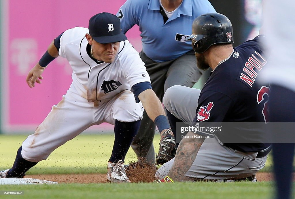 Second baseman <a gi-track='captionPersonalityLinkClicked' href=/galleries/search?phrase=Ian+Kinsler&family=editorial&specificpeople=538104 ng-click='$event.stopPropagation()'>Ian Kinsler</a> #3 of the Detroit Tigers tags out <a gi-track='captionPersonalityLinkClicked' href=/galleries/search?phrase=Mike+Napoli&family=editorial&specificpeople=525007 ng-click='$event.stopPropagation()'>Mike Napoli</a> #26 of the Cleveland Indians trying to stretch a hit into a double during the second inning at Comerica Park on June 24, 2016 in Detroit, Michigan.
