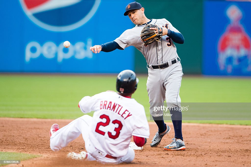 Second baseman <a gi-track='captionPersonalityLinkClicked' href=/galleries/search?phrase=Ian+Kinsler&family=editorial&specificpeople=538104 ng-click='$event.stopPropagation()'>Ian Kinsler</a> #3 of the Detroit Tigers throws out Mike Napoli #26 at first and <a gi-track='captionPersonalityLinkClicked' href=/galleries/search?phrase=Michael+Brantley+-+Baseball+Player&family=editorial&specificpeople=5742247 ng-click='$event.stopPropagation()'>Michael Brantley</a> #23 of the Cleveland Indians is out at second for a double play during the third inning at Progressive Field on May 5, 2016 in Cleveland, Ohio.