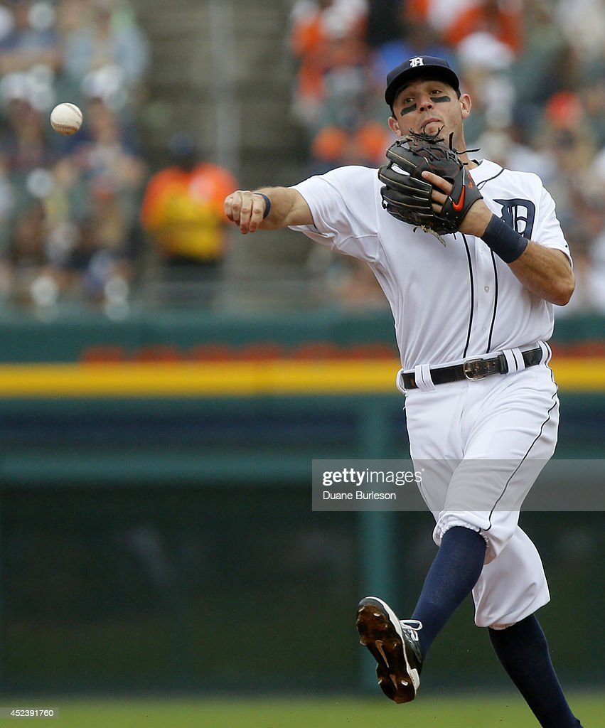 Second baseman <a gi-track='captionPersonalityLinkClicked' href=/galleries/search?phrase=Ian+Kinsler&family=editorial&specificpeople=538104 ng-click='$event.stopPropagation()'>Ian Kinsler</a> #3 of the Detroit Tigers throws to first after fielding a grounder hit by Lonnie Chisenhall of the Cleveland Indians during the eighth inning of game one of a doubleheader at Comerica Park on July 19, 2014 in Detroit, Michigan. Chisenhall beat the throw and was safe on the play.