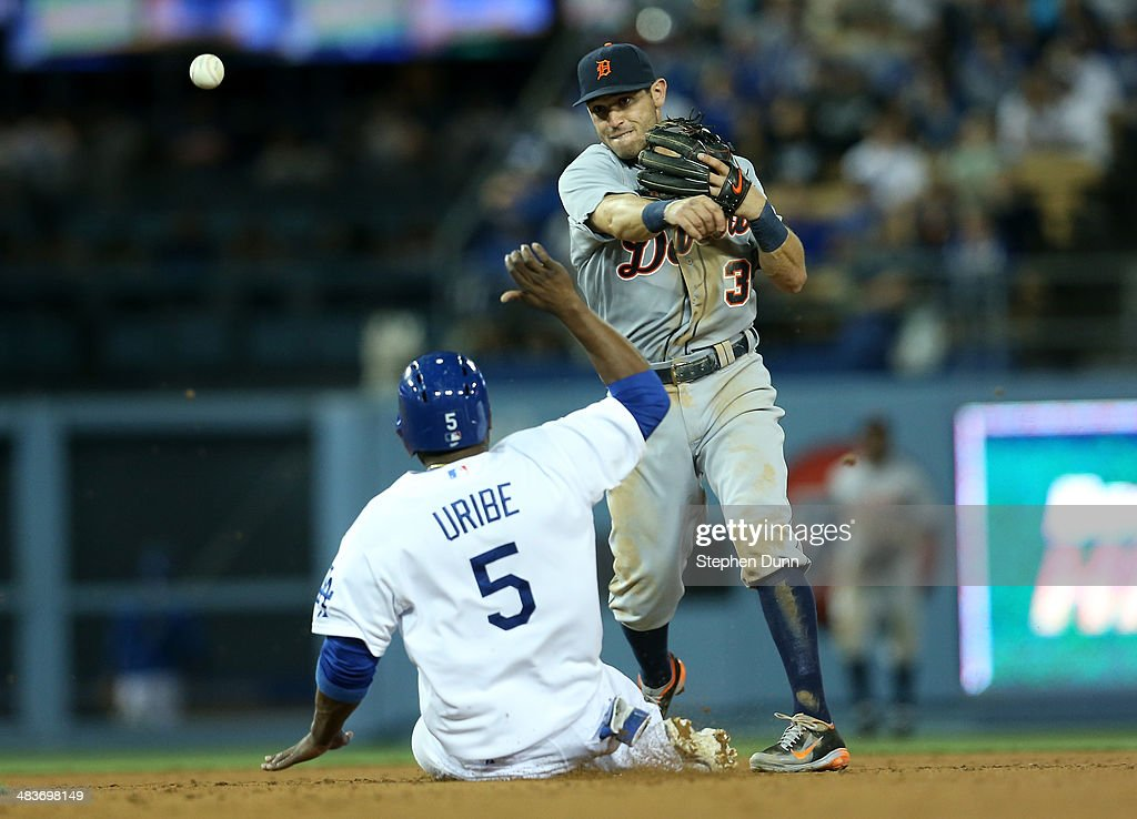 Second baseman <a gi-track='captionPersonalityLinkClicked' href=/galleries/search?phrase=Ian+Kinsler&family=editorial&specificpeople=538104 ng-click='$event.stopPropagation()'>Ian Kinsler</a> #3 of the Detroit Tigers throws to first to complete a double play after forcing out <a gi-track='captionPersonalityLinkClicked' href=/galleries/search?phrase=Juan+Uribe&family=editorial&specificpeople=209187 ng-click='$event.stopPropagation()'>Juan Uribe</a> #5 of the Los Angeles Dodgers to end the seventh inning at Dodger Stadium on April 9, 2014 in Los Angeles, California.