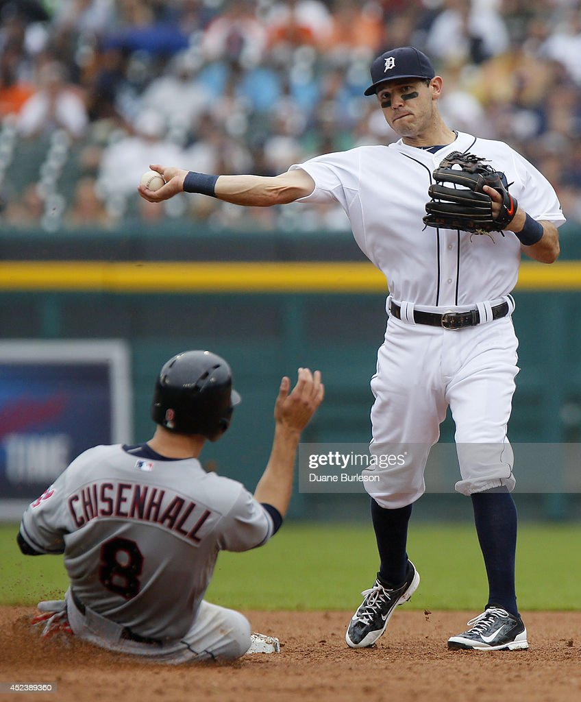 Second baseman <a gi-track='captionPersonalityLinkClicked' href=/galleries/search?phrase=Ian+Kinsler&family=editorial&specificpeople=538104 ng-click='$event.stopPropagation()'>Ian Kinsler</a> #3 of the Detroit Tigers turns the ball after getting a force out on <a gi-track='captionPersonalityLinkClicked' href=/galleries/search?phrase=Lonnie+Chisenhall&family=editorial&specificpeople=6796448 ng-click='$event.stopPropagation()'>Lonnie Chisenhall</a> #8 of the Cleveland Indians at second base during the sixth inning of game one of a doubleheader at Comerica Park on July 19, 2014 in Detroit, Michigan. Nick Swisher hit into the double play and was out at first base.