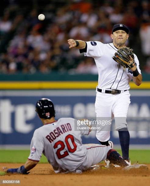 Second baseman Ian Kinsler of the Detroit Tigers turns the ball after getting a force out on Eddie Rosario of the Minnesota Twins during the eighth...