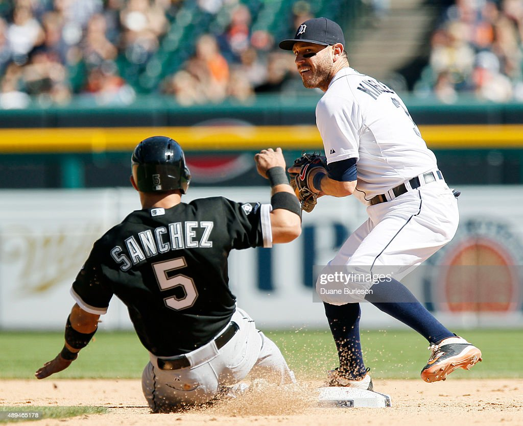Second baseman Ian Kinsler #3 of the Detroit Tigers turns to throw to first base after getting a force out on Carlos Sanchez #5 of the Chicago White Sox during the eighth inning at Comerica Park on September 21, 2015 in Detroit, Michigan. Alexei Ramirez of the Chicago White Sox was safe at first on the play. The White Sox defeated the Tigers 2-0.