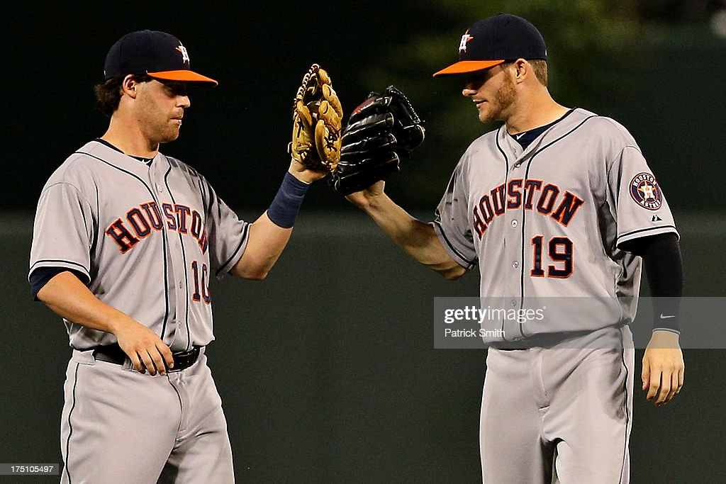 Second baseman Jake Elmore #10 of the Houston Astros and center fielder Robbie Grossman #19 celebrate after defeating the Baltimore Orioles at Oriole Park at Camden Yards on July 31, 2013 in Baltimore, Maryland. The Houston Astros won, 11-0.
