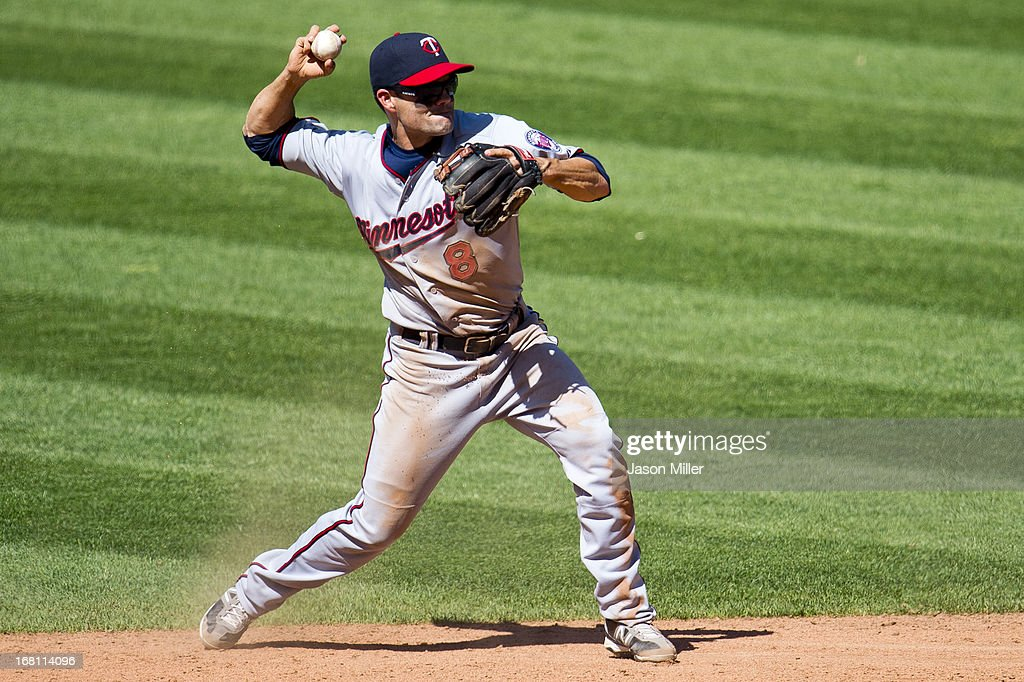 Second baseman <a gi-track='captionPersonalityLinkClicked' href=/galleries/search?phrase=Jamey+Carroll+-+Baseball+Player&family=editorial&specificpeople=211176 ng-click='$event.stopPropagation()'>Jamey Carroll</a> #8 of the Minnesota Twins throws to first for an out during the eighth inning against the Cleveland Indians at Progressive Field on May 5, 2013 in Cleveland, Ohio. The Twins defeated the Indians 4-2.