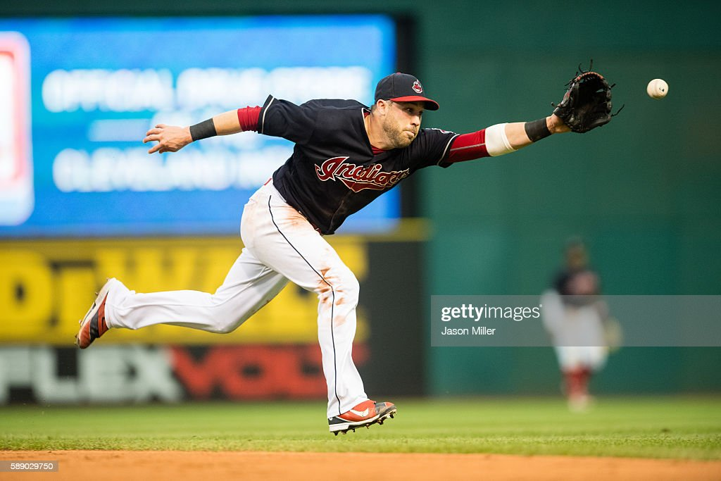 Second baseman Jason Kipnis of the Cleveland Indians can't get to a line drive hit by Cliff Pennington of the Los Angeles Angels of Anaheim for a...