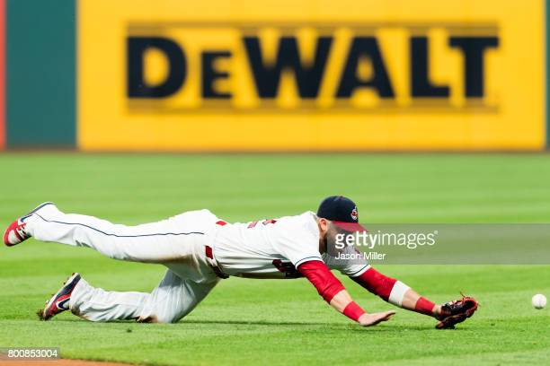 Second baseman Jason Kipnis of the Cleveland Indians can't get to a ground ball hit by Yasiel Puig of the Los Angeles Dodgers during the eighth...