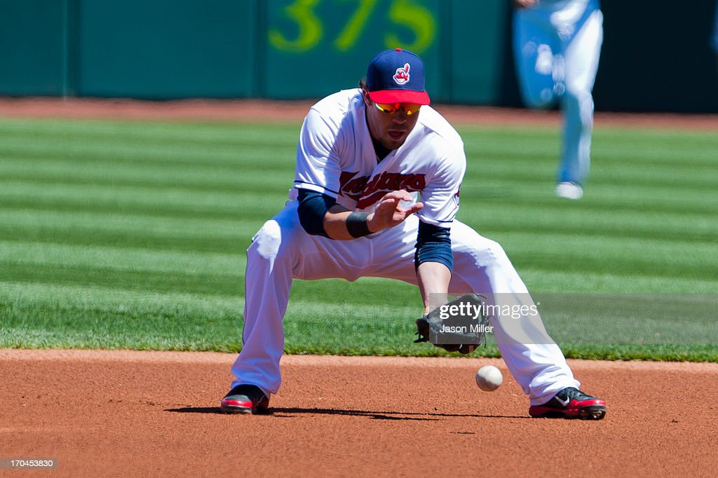 Second baseman <a gi-track='captionPersonalityLinkClicked' href=/galleries/search?phrase=Jason+Kipnis&family=editorial&specificpeople=5330784 ng-click='$event.stopPropagation()'>Jason Kipnis</a> #22 of the Cleveland Indians catches a ground ball during the first inning against the New York Yankees during the first game of a doubleheader at Progressive Field on May 13, 2013 in Cleveland, Ohio.