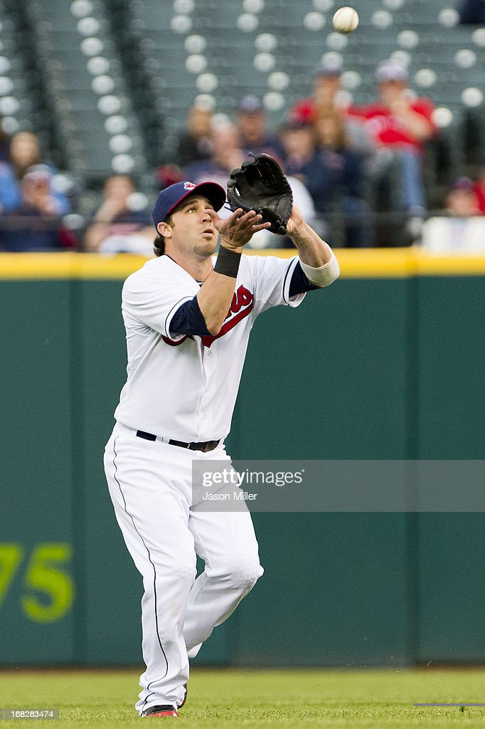 Second baseman <a gi-track='captionPersonalityLinkClicked' href=/galleries/search?phrase=Jason+Kipnis&family=editorial&specificpeople=5330784 ng-click='$event.stopPropagation()'>Jason Kipnis</a> #22 of the Cleveland Indians catches a pop fly hit by Yoenis Cespedes #52 of the Oakland Athletics during the second inning at Progressive Field on May 7, 2013 in Cleveland, Ohio.