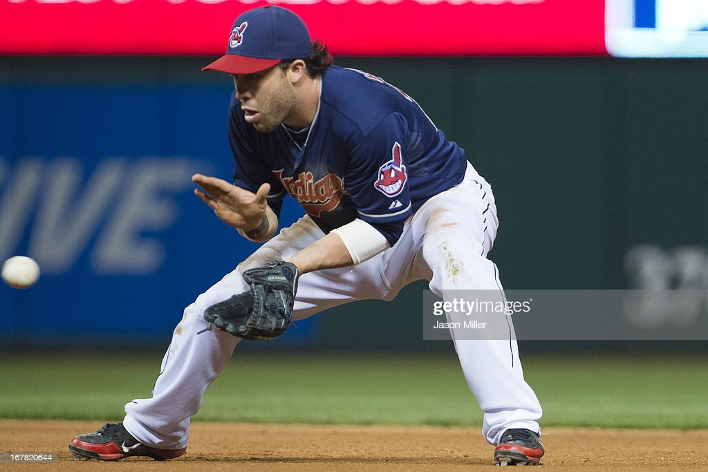 Second baseman <a gi-track='captionPersonalityLinkClicked' href=/galleries/search?phrase=Jason+Kipnis&family=editorial&specificpeople=5330784 ng-click='$event.stopPropagation()'>Jason Kipnis</a> #22 of the Cleveland Indians fields a ground ball hit by Ben Revere #2 of the Philadelphia Phillies for a double play during the seventh inning at Progressive Field on April 30, 2013 in Cleveland, Ohio.