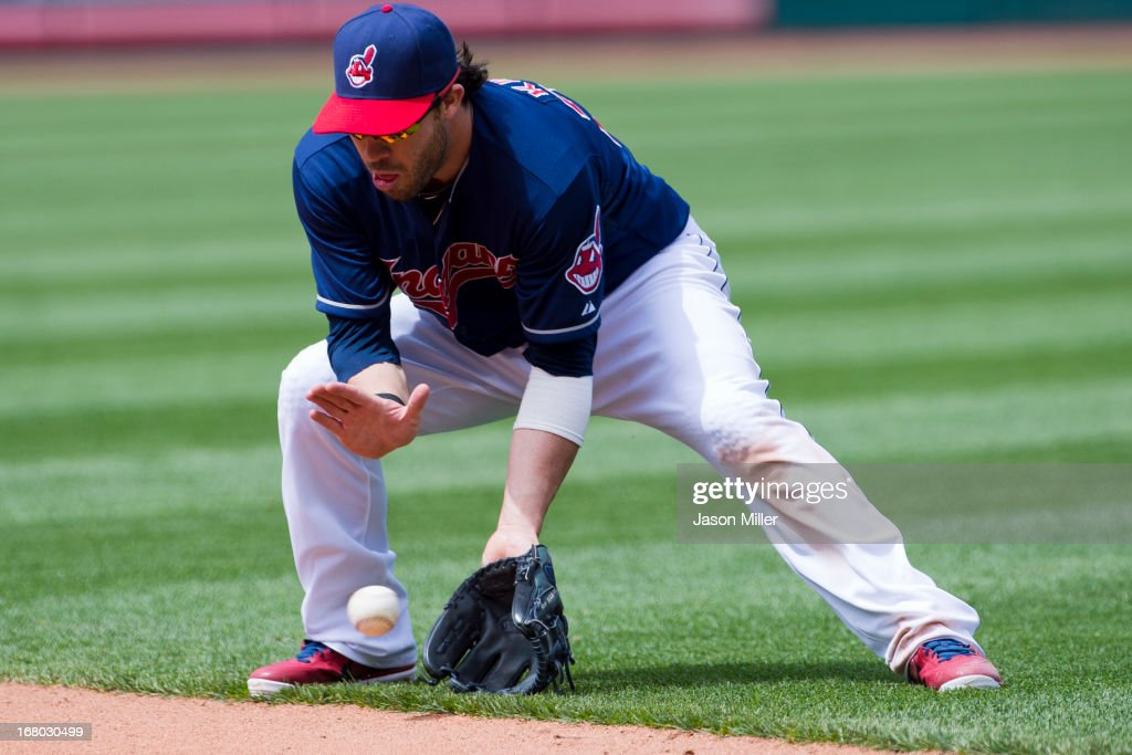 Second baseman <a gi-track='captionPersonalityLinkClicked' href=/galleries/search?phrase=Jason+Kipnis&family=editorial&specificpeople=5330784 ng-click='$event.stopPropagation()'>Jason Kipnis</a> #22 of the Cleveland Indians fields a ground ball hit by Joe Mauer #7 of the Minnesota Twins to end the top of the fifth inning at Progressive Field on May 4, 2013 in Cleveland, Ohio.