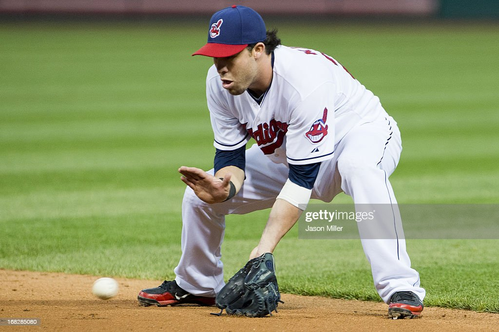 Second baseman <a gi-track='captionPersonalityLinkClicked' href=/galleries/search?phrase=Jason+Kipnis&family=editorial&specificpeople=5330784 ng-click='$event.stopPropagation()'>Jason Kipnis</a> #22 of the Cleveland Indians fields a ground ball hit by Jed Lowrie #8 of the Oakland Athletics to end the sixth inning at Progressive Field on May 7, 2013 in Cleveland, Ohio.