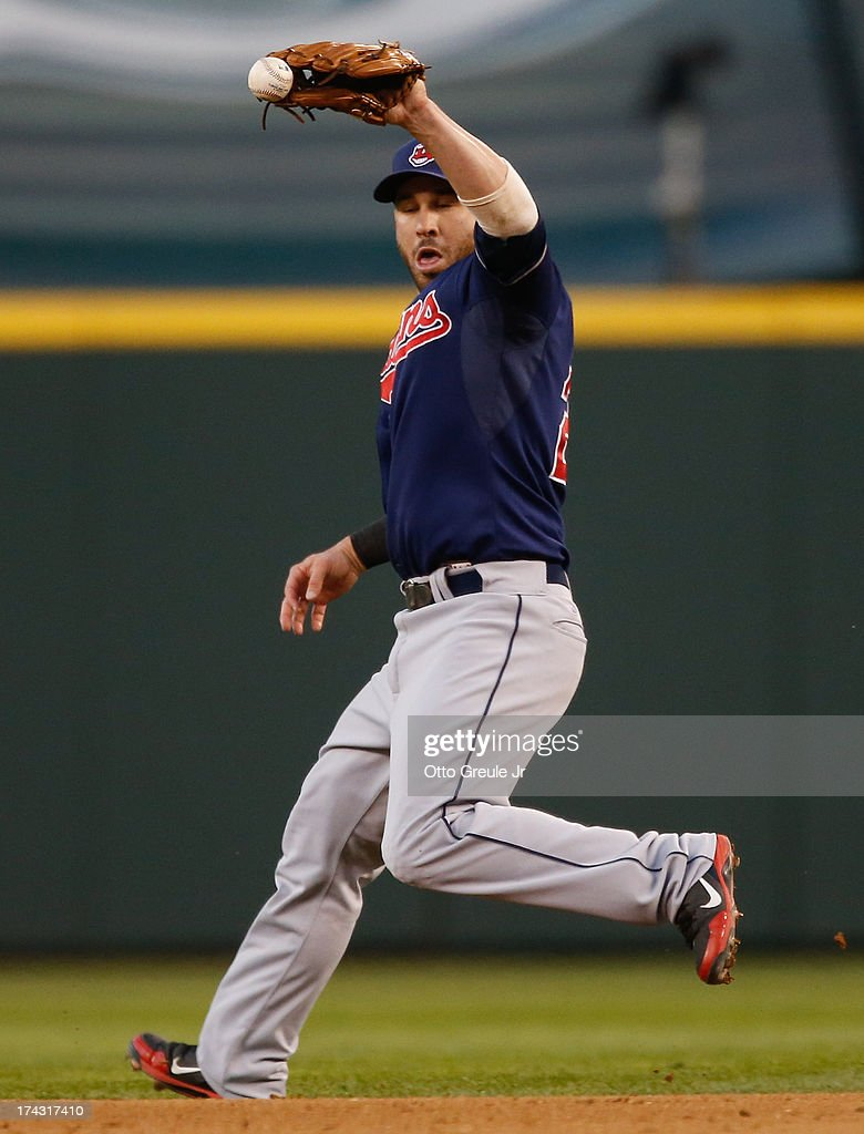 Second baseman <a gi-track='captionPersonalityLinkClicked' href=/galleries/search?phrase=Jason+Kipnis&family=editorial&specificpeople=5330784 ng-click='$event.stopPropagation()'>Jason Kipnis</a> #22 of the Cleveland Indians has trouble fielding a groundout by Kendrys Morales of the Seattle Mariners in the fifth inning at Safeco Field on July 23, 2013 in Seattle, Washington.