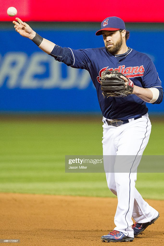 Second baseman Jason Kipnis #22 of the Cleveland Indians throws out Billy Butler #16 of the Kansas City Royals at first during the seventh inning at Progressive Field on April 22, 2014 in Cleveland, Ohio.