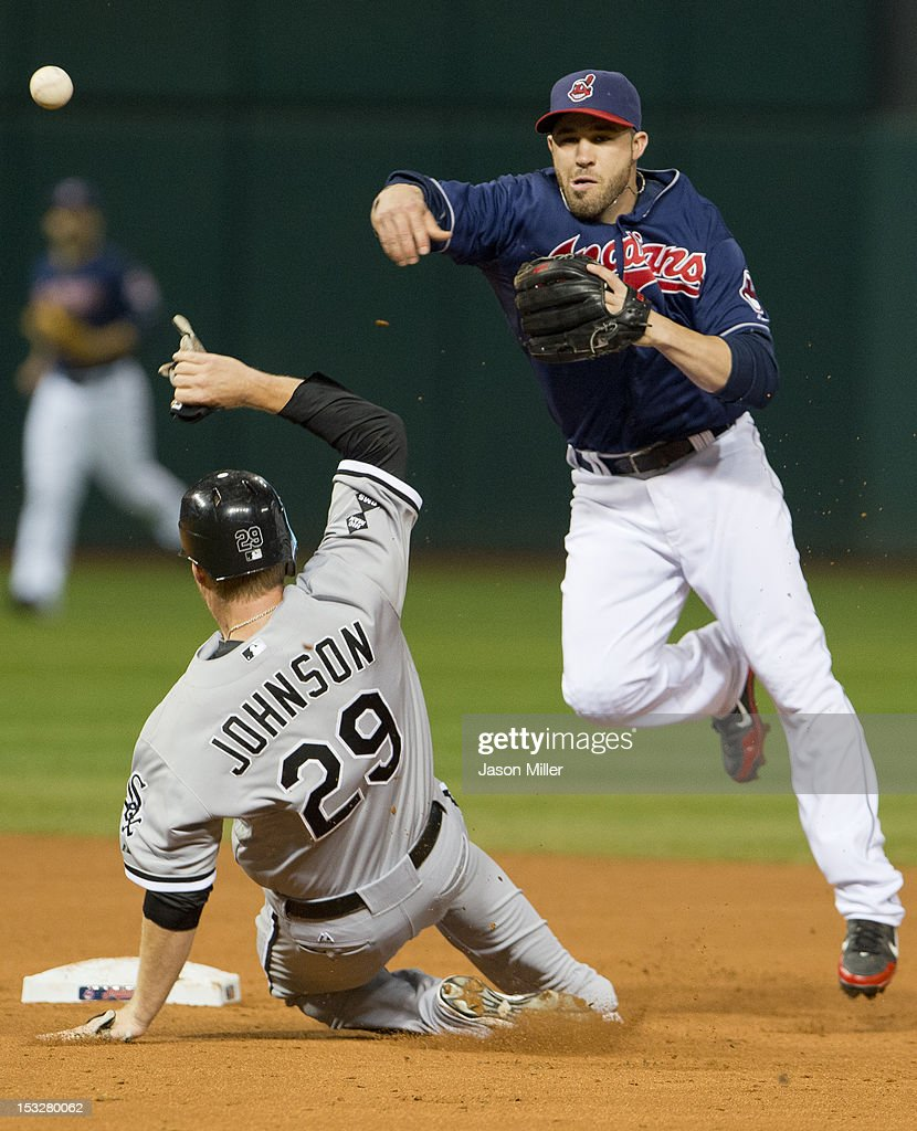 Second baseman <a gi-track='captionPersonalityLinkClicked' href=/galleries/search?phrase=Jason+Kipnis&family=editorial&specificpeople=5330784 ng-click='$event.stopPropagation()'>Jason Kipnis</a> #22 of the Cleveland Indians throws to first base as Dan Johnson #29 of the Chicago White Sox is out at second during the third inning at Progressive Field on October 2, 2012 in Cleveland, Ohio.