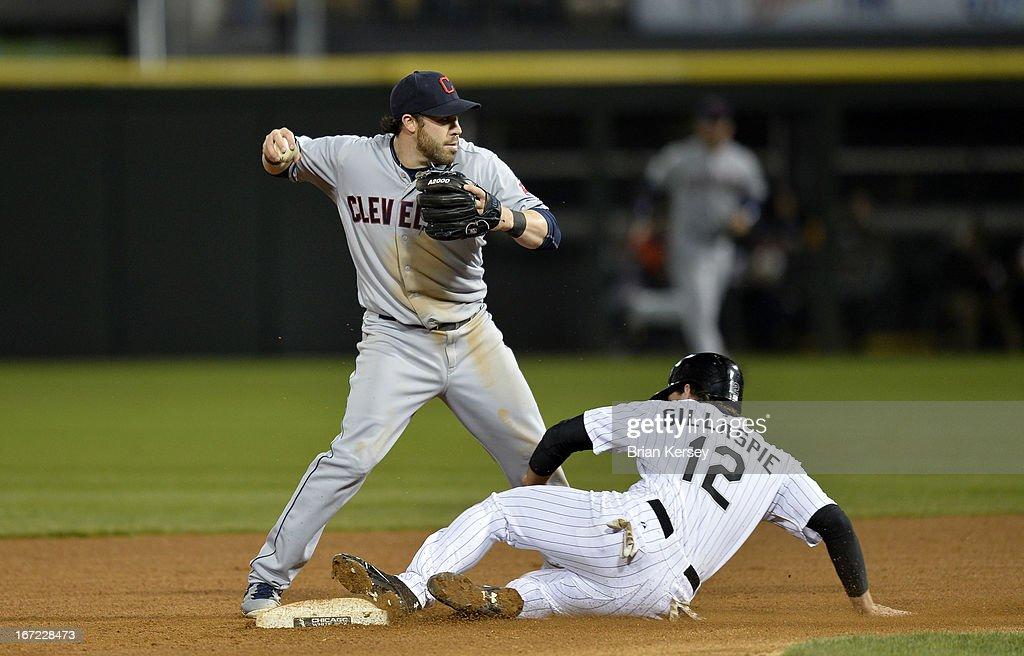Second baseman <a gi-track='captionPersonalityLinkClicked' href=/galleries/search?phrase=Jason+Kipnis&family=editorial&specificpeople=5330784 ng-click='$event.stopPropagation()'>Jason Kipnis</a> #22 of the Cleveland Indians (L) throws to first base after forcing out Conor Gillaspie #12 of the Chicago White Sox at second on a ground ball hit by Alexei Ramirez during the fourth inning on April 22, 2012 at U.S. Cellular Field in Chicago, Illinois. Ramirez was safe at first base.