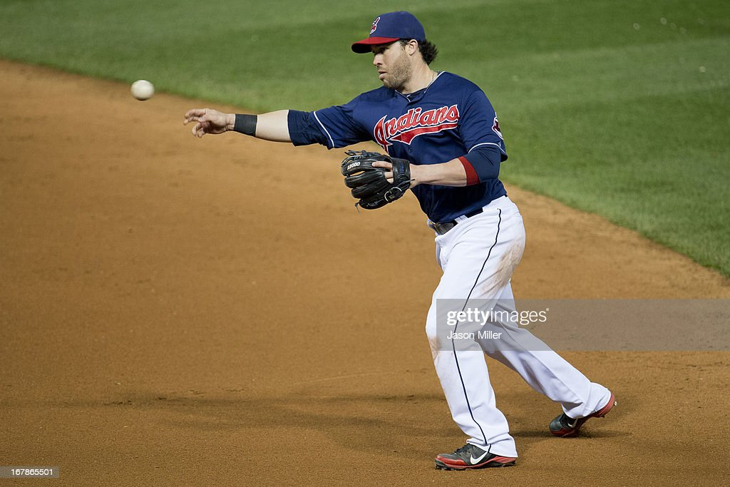 Second baseman <a gi-track='captionPersonalityLinkClicked' href=/galleries/search?phrase=Jason+Kipnis&family=editorial&specificpeople=5330784 ng-click='$event.stopPropagation()'>Jason Kipnis</a> #22 of the Cleveland Indians throws to first during the seventh inning against the Philadelphia Phillies at Progressive Field on May 1, 2013 in Cleveland, Ohio. The Indians defeated the Phillies 6-0.