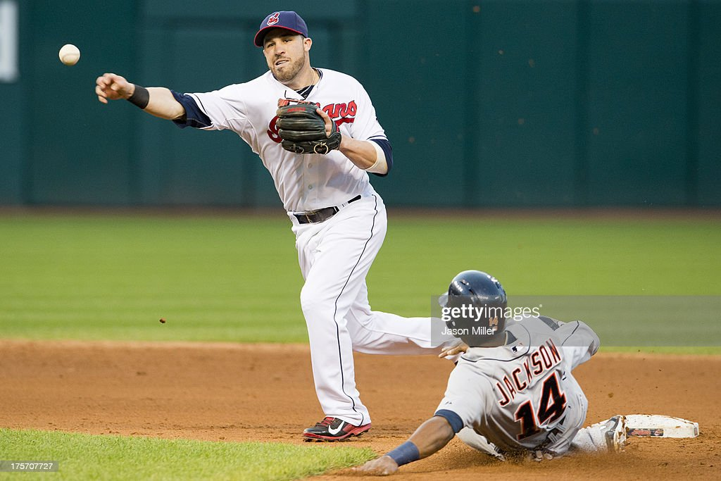 Second baseman <a gi-track='captionPersonalityLinkClicked' href=/galleries/search?phrase=Jason+Kipnis&family=editorial&specificpeople=5330784 ng-click='$event.stopPropagation()'>Jason Kipnis</a> #22 of the Cleveland Indians throws to first as Austin Jackson #14 of the Detroit Tigers is out at second during the fifth inning at Progressive Field on August 6, 2013 in Cleveland, Ohio.