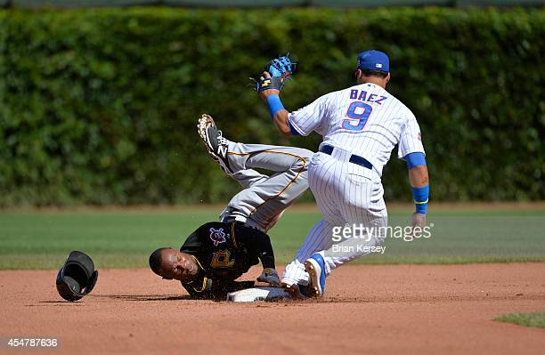 Second baseman Javier Baez of the Chicago Cubs tags out Starling Marte of the Pittsburgh Pirates as he tries to steal second base during the tenth...