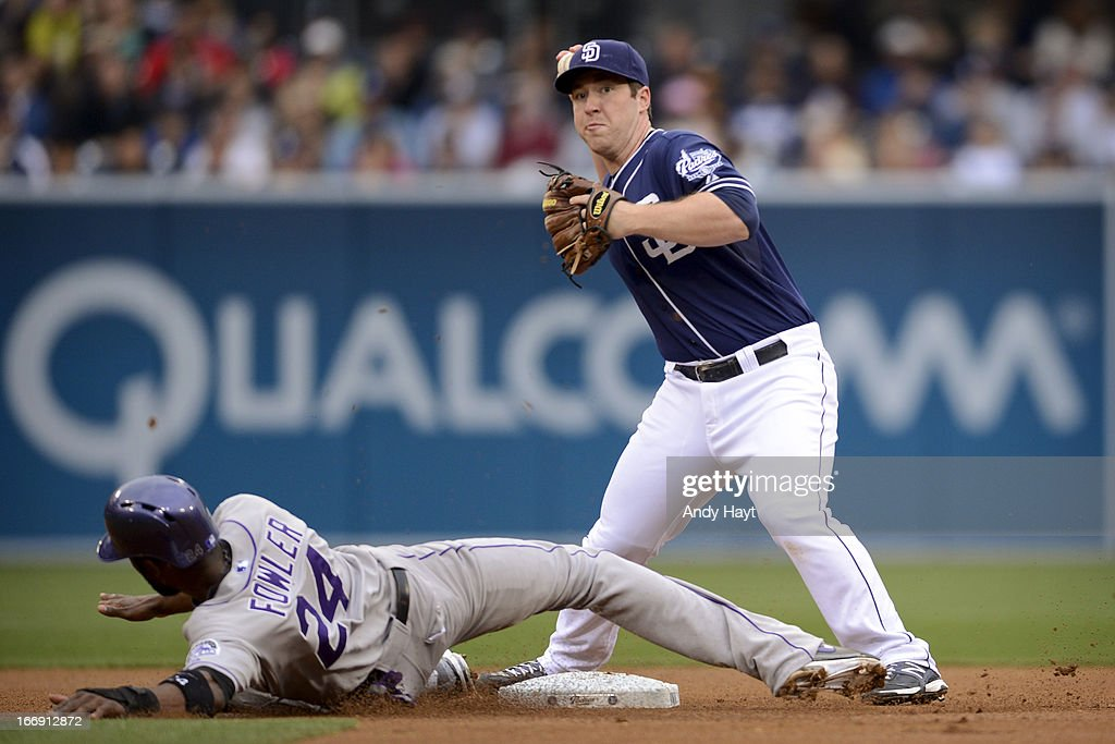 Second baseman Jedd Gyorko #9 of the San Diego Padres throws to first base after tagging out <a gi-track='captionPersonalityLinkClicked' href=/galleries/search?phrase=Dexter+Fowler&family=editorial&specificpeople=4949024 ng-click='$event.stopPropagation()'>Dexter Fowler</a> #24 of the Colorado Rockies at Petco Park on April 13, 2013 in San Diego, California.