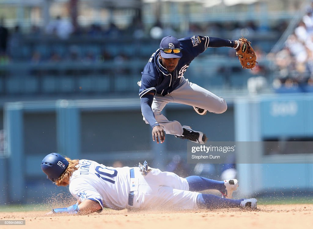 Second baseman Jemile Weeks #8 of the San Diego Padres jumps over Justin Turner #10 of the Los Angeles Dodgers as he turns a double play in the seventh inning at Dodger Stadium on May 1, 2016 in Los Angeles, California.