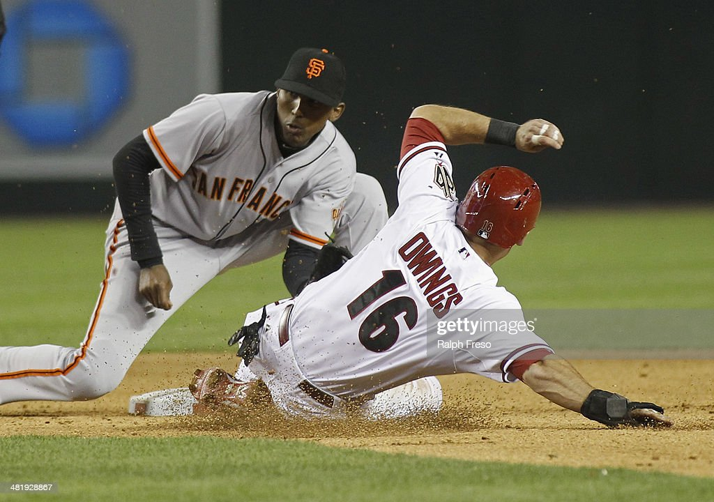 Second baseman Joaquin Arias #13 of the San Francisco Giants applies a late tag as Chris Owing #16 of the Arizona Diamondbacks slides safely into second with a stolen base during the sixth inning of a MLB game at Chase Field on April 1, 2014 in Phoenix, Arizona.