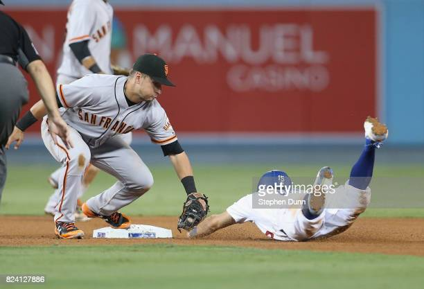 Second baseman Joe Panik of the San Francisco Giants tags out Austin Barnes of the Los Angeles Dodgers attempting to steal second in the eighth...