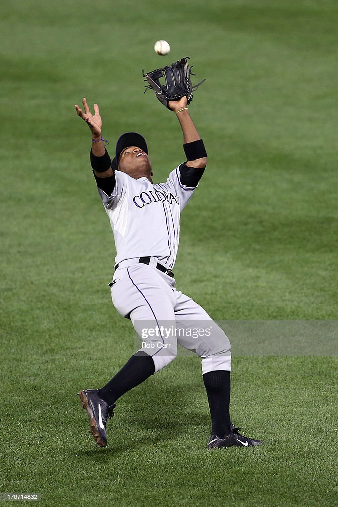 Second baseman <a gi-track='captionPersonalityLinkClicked' href=/galleries/search?phrase=Jonathan+Herrera&family=editorial&specificpeople=4175178 ng-click='$event.stopPropagation()'>Jonathan Herrera</a> #18 of the Colorado Rockies catches a ball hit by Ryan Flaherty #3 of the Baltimore Orioles (not pictured) for the first out of the third inning at Oriole Park at Camden Yards on August 17, 2013 in Baltimore, Maryland.