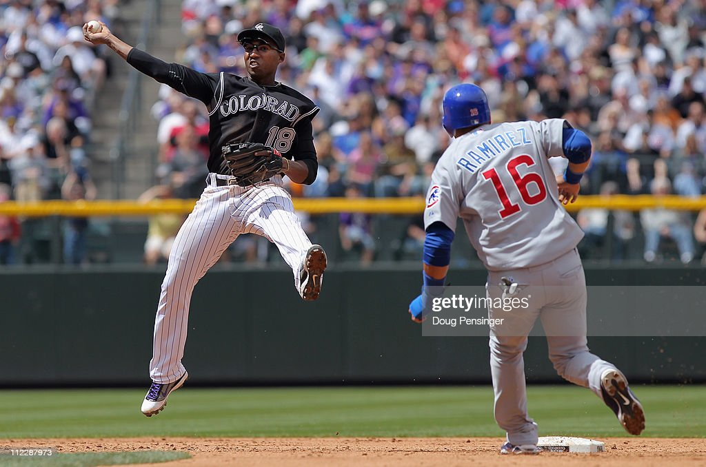 Second baseman Jonathan Herrera of the Colorado Rockies gets a force out on Aramis Ramirez of the Chicago Cubs at Coors Field on April 17 2011 in...