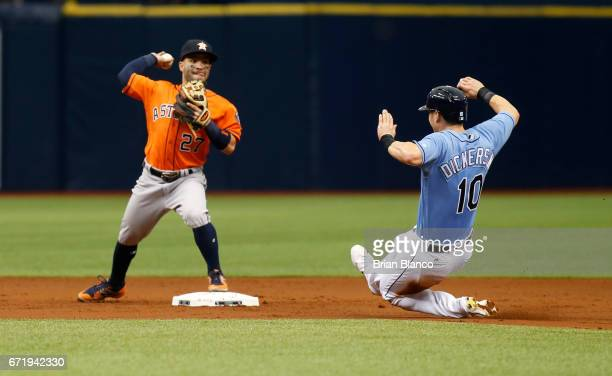 Second baseman Jose Altuve of the Houston Astros gets the forced out at second base on Corey Dickerson of the Tampa Bay Rays after Evan Longoria...