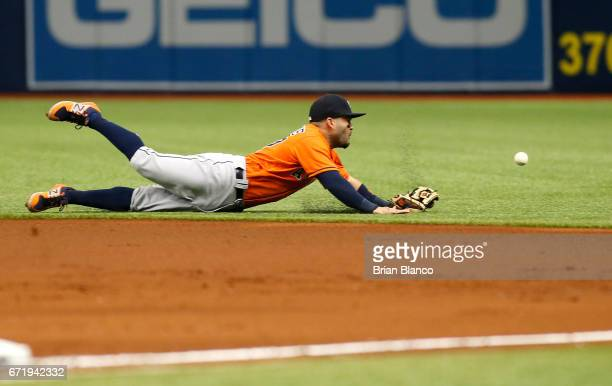 Second baseman Jose Altuve of the Houston Astros makes an attempt on the single by Shane Peterson of the Tampa Bay Rays during the first inning of a...