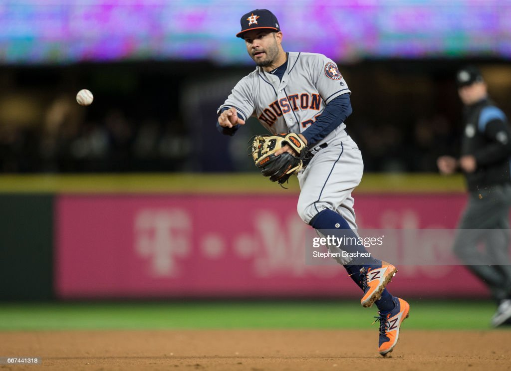 Second baseman Jose Altuve #27 of the Houston Astros throws out Leonys Martin #12 of the Seattle Mariners to end the fourth inning of game at Safeco Field on April 11, 2017 in Seattle, Washington.