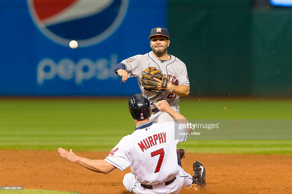 Second baseman <a gi-track='captionPersonalityLinkClicked' href=/galleries/search?phrase=Jose+Altuve&family=editorial&specificpeople=7934195 ng-click='$event.stopPropagation()'>Jose Altuve</a> #27 of the Houston Astros throws out Yan Gomes #10 of the Cleveland Indians at first as <a gi-track='captionPersonalityLinkClicked' href=/galleries/search?phrase=David+Murphy+-+Baseball+Player&family=editorial&specificpeople=4604222 ng-click='$event.stopPropagation()'>David Murphy</a> #7 is out at second for a double play during the sixth inning at Progressive Field on July 7, 2015 in Cleveland, Ohio.