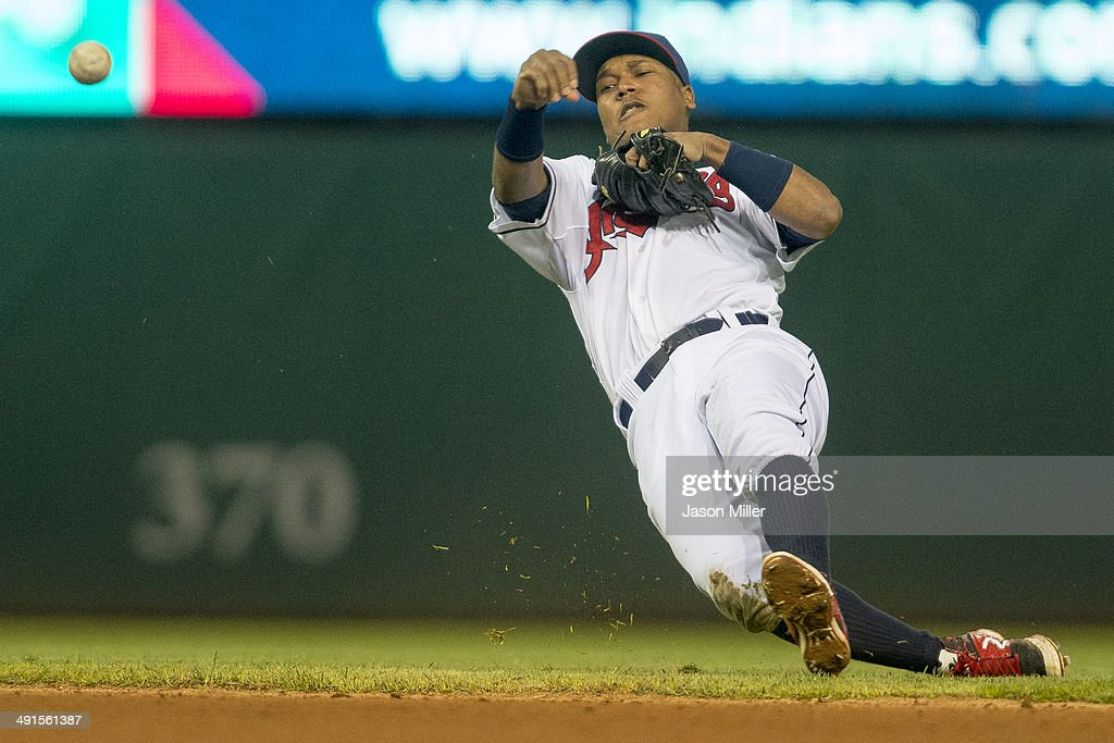 Second baseman Jose Ramirez #11 of the Cleveland Indians throws out Eric Sogard #28 of the Oakland Athletics at first to end the top of the fifth inning at Progressive Field on May 16, 2014 in Cleveland, Ohio.