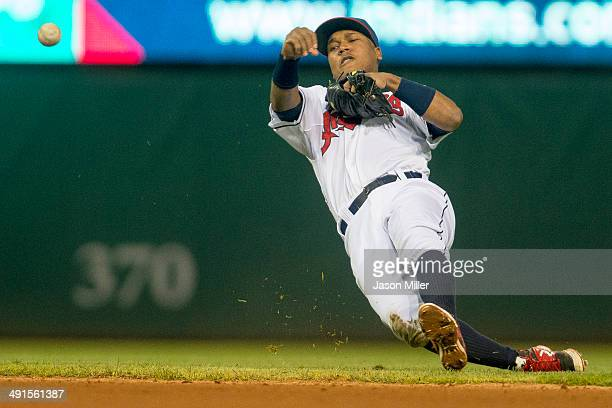 Second baseman Jose Ramirez of the Cleveland Indians throws out Eric Sogard of the Oakland Athletics at first to end the top of the fifth inning at...