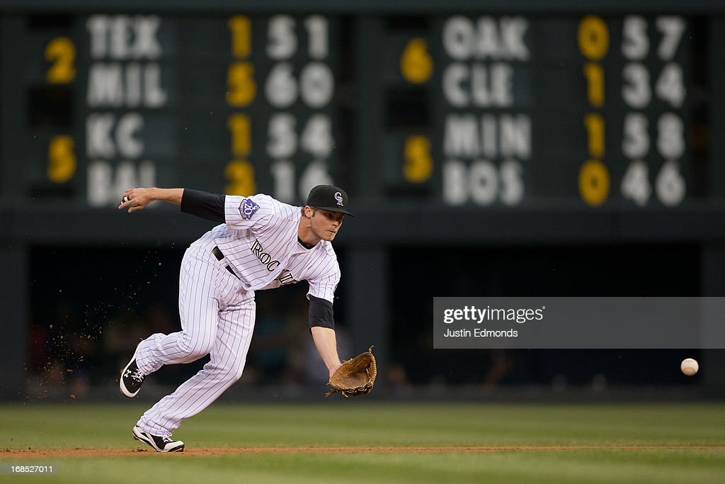 Second baseman <a gi-track='captionPersonalityLinkClicked' href=/galleries/search?phrase=Josh+Rutledge&family=editorial&specificpeople=9541486 ng-click='$event.stopPropagation()'>Josh Rutledge</a> #14 of the Colorado Rockies fields a ground ball against the New York Yankees at Coors Field on May 7, 2013 in Denver, Colorado.