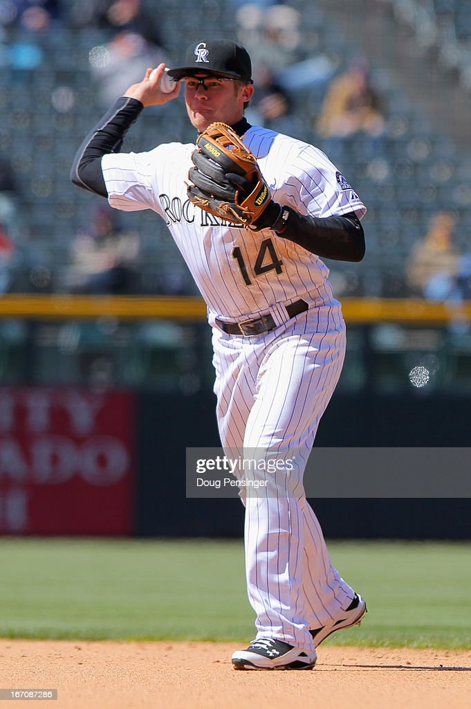 Second baseman <a gi-track='captionPersonalityLinkClicked' href=/galleries/search?phrase=Josh+Rutledge&family=editorial&specificpeople=9541486 ng-click='$event.stopPropagation()'>Josh Rutledge</a> #14 of the Colorado Rockies throws out a runner against the New York Mets at Coors Field on April 18, 2013 in Denver, Colorado. The Rockies defeated the Mets 11-3.