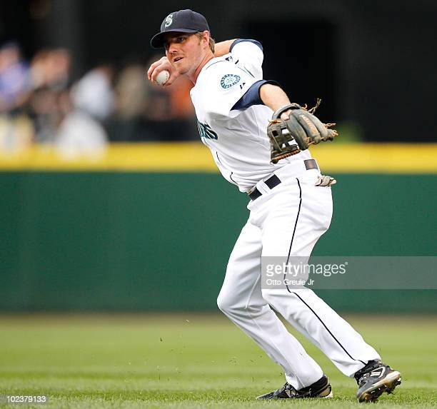 Second baseman Josh Wilson of the Seattle Mariners throws to first base during the game against the Chicago Cubs on June 22 2010 at Safeco Field in...