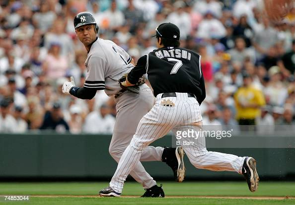 Second baseman Kazuo Matsui of the Colorado Rockies catches Derek Jeter of the New York Yankees in a rundown between second and third base in the...