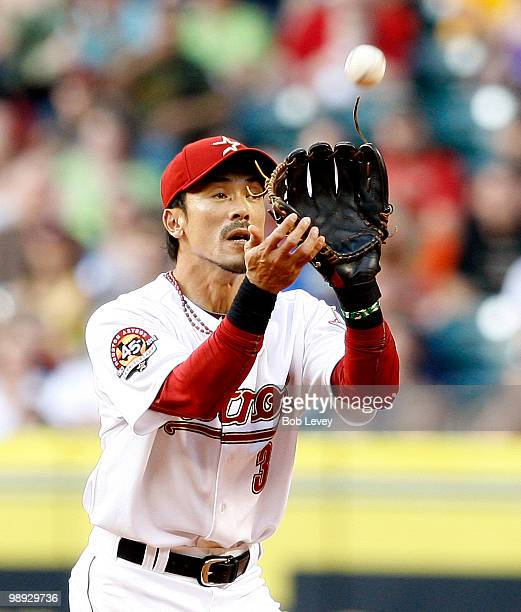 Second baseman Kazuo Matsui of the Houston Astros makes a catch on a pop fly hit by Kyle Blanks of the San Diego Padres in the fifth inning at Minute...