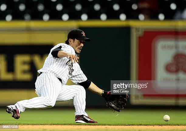 Second baseman Kazuo Matsui of the Houston Astros makes a sliding stop on a ball hit by Gerardo Parra of the Arizona Diamondbacks in the ninth inning...
