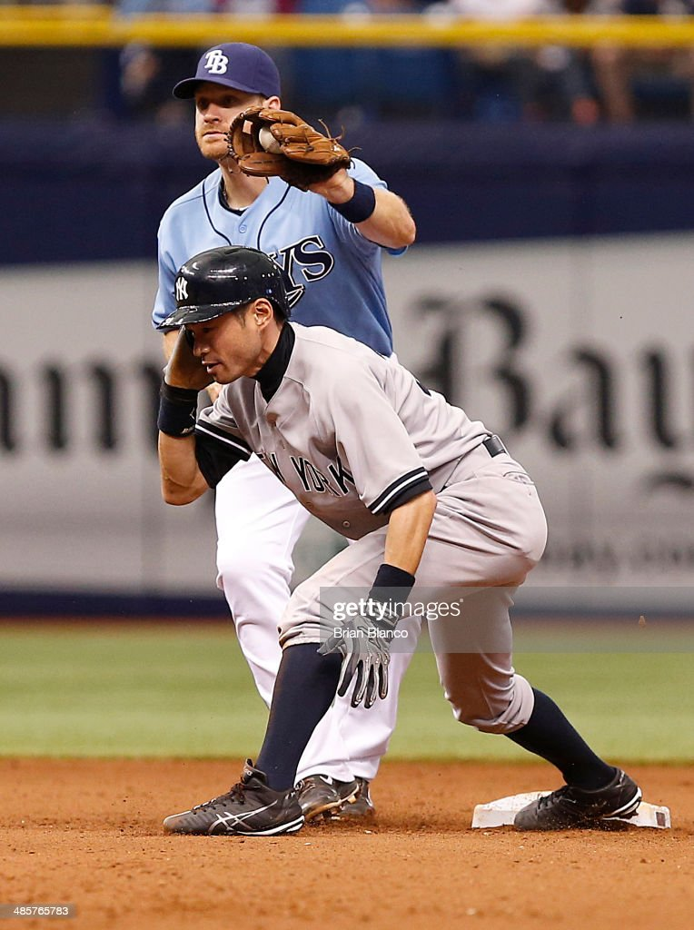 Second baseman <a gi-track='captionPersonalityLinkClicked' href=/galleries/search?phrase=Logan+Forsythe&family=editorial&specificpeople=4412508 ng-click='$event.stopPropagation()'>Logan Forsythe</a> #10 of the Tampa Bay Rays catches <a gi-track='captionPersonalityLinkClicked' href=/galleries/search?phrase=Ichiro+Suzuki&family=editorial&specificpeople=201556 ng-click='$event.stopPropagation()'>Ichiro Suzuki</a> #31 of the New York Yankees attempting to steal second base during the 11th inning of a game on April 20, 2014 at Tropicana Field in St. Petersburg, Florida.