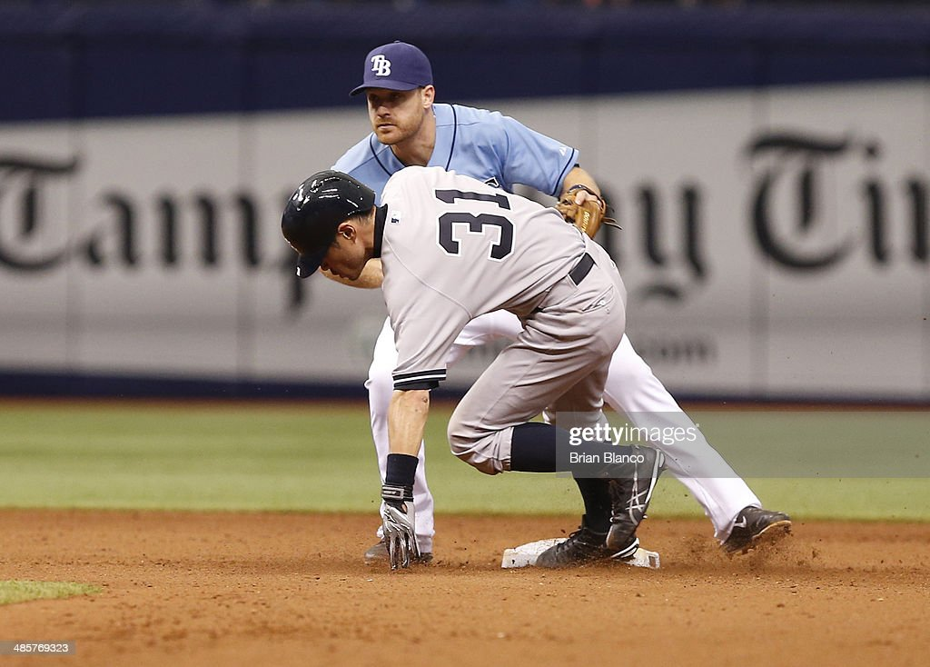 Second baseman Logan Forsythe #10 of the Tampa Bay Rays catches Ichiro Suzuki #31 of the New York Yankees attempting to steal second base during the 11th inning of a game on April 20, 2014 at Tropicana Field in St. Petersburg, Florida.