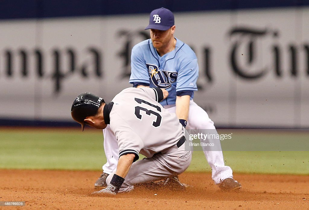 Second baseman <a gi-track='captionPersonalityLinkClicked' href=/galleries/search?phrase=Logan+Forsythe&family=editorial&specificpeople=4412508 ng-click='$event.stopPropagation()'>Logan Forsythe</a> #10 of the Tampa Bay Rays catches <a gi-track='captionPersonalityLinkClicked' href=/galleries/search?phrase=Ichiro+Suzuki&family=editorial&specificpeople=201556 ng-click='$event.stopPropagation()'>Ichiro Suzuki</a> #31 of the New York Yankees attempting to steal second during the 11th inning of a game on April 20, 2014 at Tropicana Field in St. Petersburg, Florida.