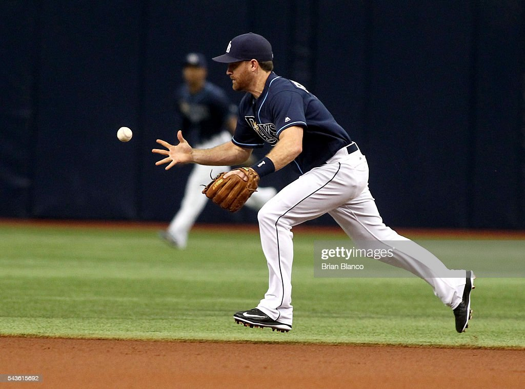 Second baseman <a gi-track='captionPersonalityLinkClicked' href=/galleries/search?phrase=Logan+Forsythe&family=editorial&specificpeople=4412508 ng-click='$event.stopPropagation()'>Logan Forsythe</a> #11 of the Tampa Bay Rays fails to haul in the ground ball by Dustin Pedroia of the Boston Red Sox allowing Pedroia to reach on the error during the first inning of a game on June 29, 2016 at Tropicana Field in St. Petersburg, Florida.